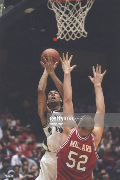 Center Brad Millard of the St Mary''s Gaels tries to block as center Tim Duncan of the Wake Forest Demon Deacons goes for the basket during a playoff...
