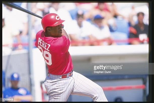 Cincinnati Reds third baseman Eduardo Perez swings at a pitch during a spring training game against the Toronto Blue Jays at Dunedin Stadium in...