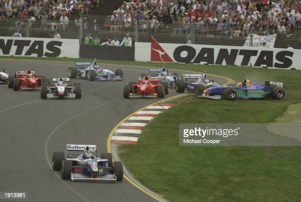Eddie Irvine of Ireland in his ferrari Jacques Villeneuve of Canada in his Williams Renault and Johnny Herbert of Great Britain in his Sauber...