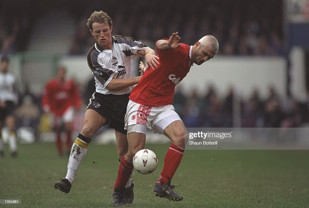 Fabrizio Ravanelli (right) of Middlesbrough is pursued by Gary Rowett of Derby County in the FA Cup Quarter Final at the Baseball Ground, Derby. \ Mandatory Credit: Shaun Botterill /Allsport