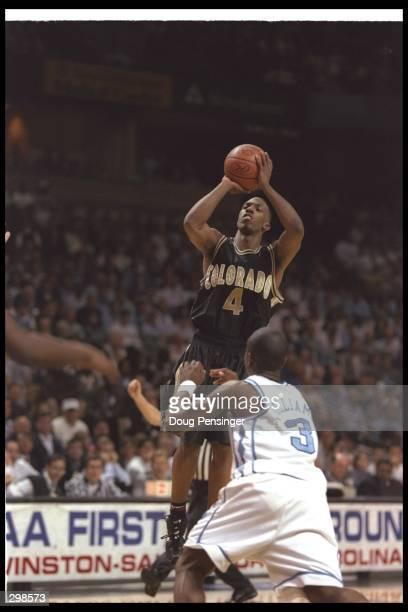 Guard Chauncey Billups of the Colorado Buffaloes shoots the ball as guard Shammond Williams of the North Carolina Tarheels tries to guard him during...