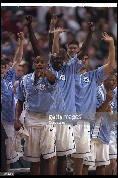Guard Vince Carter of the North Carolina Tarheels cheers for his teammate during a playoff game against the North Carolina State Wolfpack at the...