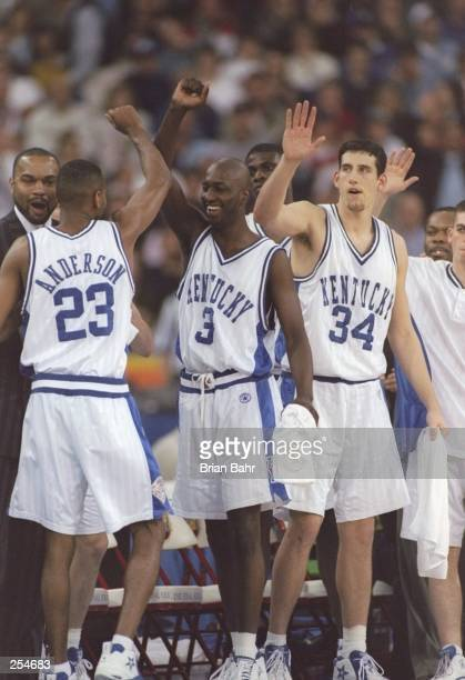 Guard Wayne Turner of the Kentucky Wildcats gives high fives to teammates forwards Allen Edward and Jared Prickett during a NCAA Final Four game...
