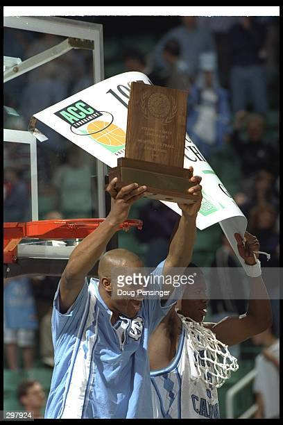 Guards Vince Carter and Shammond Williams of the North Carolina Tarheels celebrates after a playoff game against the North Carolina State Wolfpack at...
