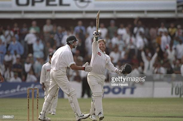Ian Healy of Australia celebrates as Australia win the second test match against South Africa at Port Elizabeth South Africa Mandatory Credit Mike...