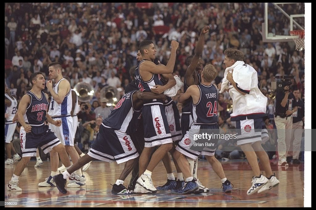 Members of Arizona Wildcats celebrate after the NCAA Championship game against the Kentucky Wildcats at the RCA Dome in Indianapolis, Indiana. Arizona won the game 84 - 79. Mandatory Credit: Brian Bahr /Allsport