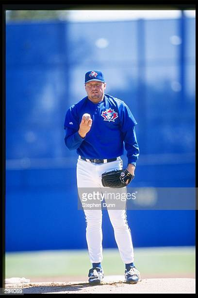Pitcher Roger Clemens of the Toronto Blue Jays stands on the mound during a preseason game against the Cincinnati Reds at Dunedin Stadium in Dunedin...