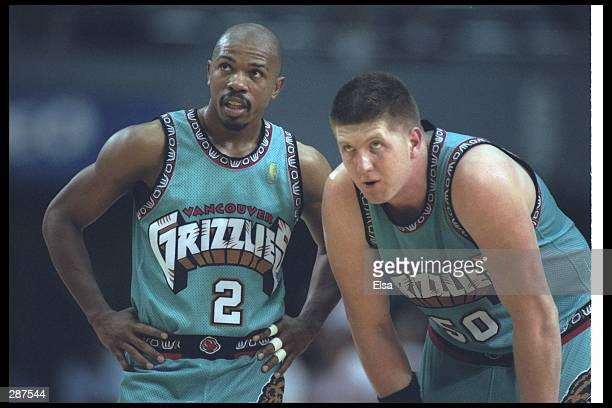Vancouver Grizzlies guard Greg Anthony and teammate center Bryant Reeves look on during a game against the Los Angeles Clippers at the Los Angeles...