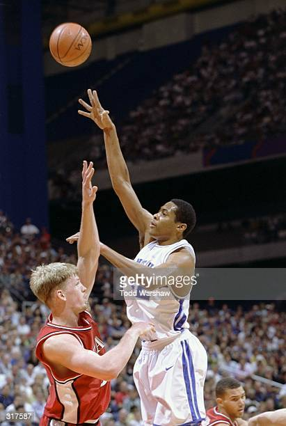 Center Jamaal Magloire of the Kentucky Wildcats in action against center Michael Doleac of the Utah Utes during the NCAA championship game at the...