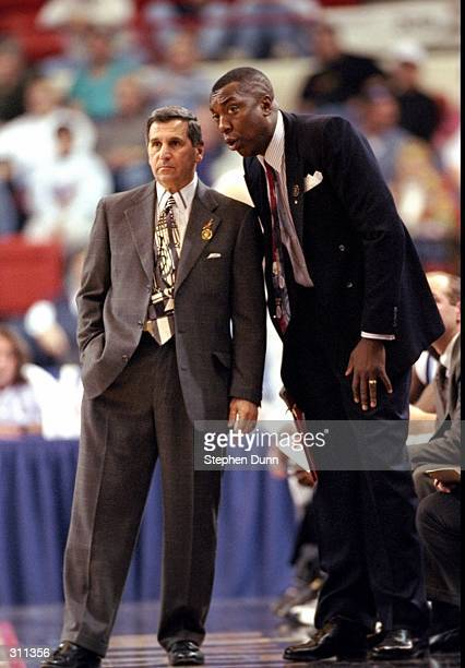 Coach Jim Harrick of the Rhode Island Rams confers with assistant coach Carry Farmer during a game against the Murray State Racers in the first round...
