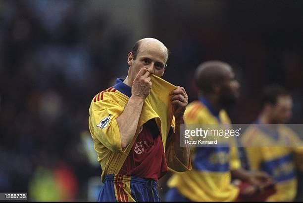 Crystal Palace Coach Attilio Lombardo kisses his shirt during an FA Carling Premiership match against Aston Villa at Villa Park in Birmingham,...