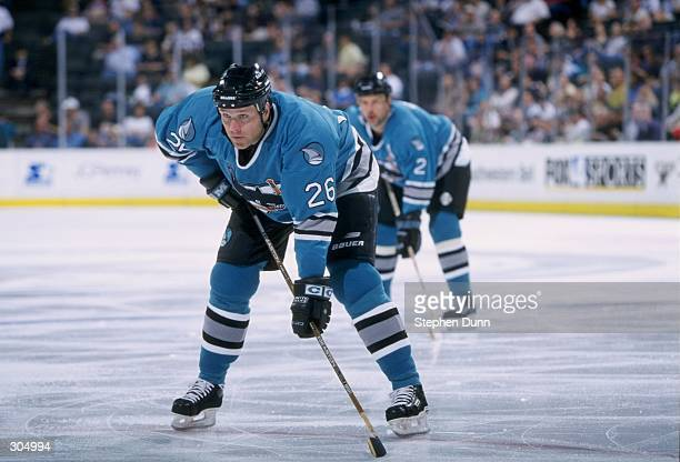 Defenseman Bill Houlder and left wing Dave Lowry of the San Jose Sharks in action during a game against the Dallas Stars at Reunion Arena in Dallas...