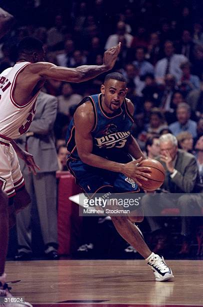 Forward Grant Hill of the Detroit Pistons in action against guard Scottie Pippen of the Chicago Bulls during a game at the United Center in Chicago...