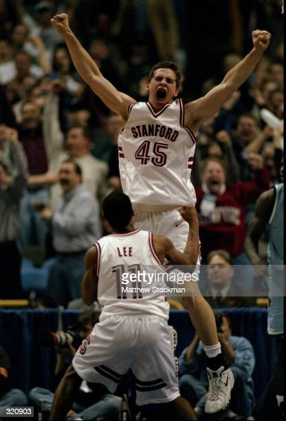 Forward Mark Madsen and guard Arthur Lee of the Stanford Cardinal in action during an NCAA Tournament game against the Rhode Island Rams at the Kiel...