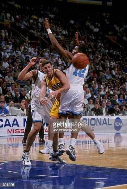 Guard Bryce Drew of the Valparaiso Crusaders in action against guard Cuttino Mobley of the Rhode Island Rams during an NCAA Tournament game at the...