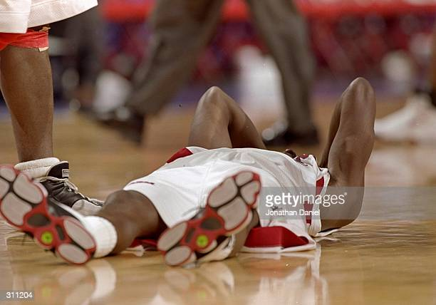 Guard Felipe Lopez of the St Johns Red Storm lies on the court during a game against the Detroit Titans in the first round of the NCAA Tournament at...