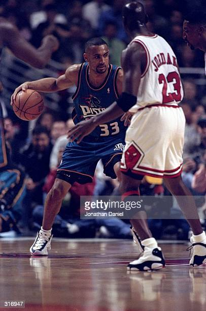 Guard Michael Jordan of the Chicago Bulls in action forward Grant Hill of the Detroit Pistons during a game at the United Center in Chicago Illinois...