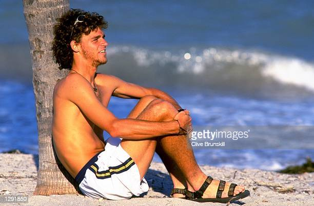 Gustavo Kuerten of Brazil relaxes in the sun during the 1998 Lipton Championships held in Key Biscayne Florida USA Mandatory Credit Clive Brunskill...