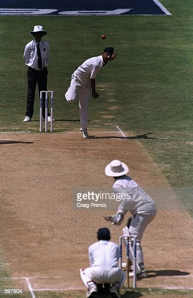Harbajan Singh of India shows his bowling skills against Australia''s Mark Taylor during the match between India and Australia in the third test...