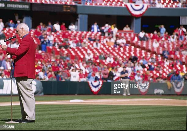 Jack Buck speaks before the game between the St Louis Cardinals and the Los Angeles Dodgers at Busch Stadium in St Louis Missouri on March 31 1998...