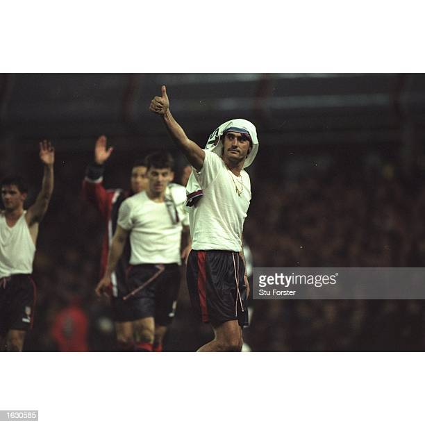 Jose Caminero of Atletico Madrid gives a thumbs up to the fans after the second leg of the UEFA Cup tie against Aston Villa at Villa Park in...
