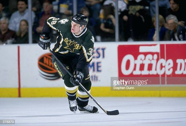 Leftwinger Jason Botterill of the Dallas Stars in action during a game against the Pittsburgh Penguins at the Reunion Arena in Dallas, Texas. The...