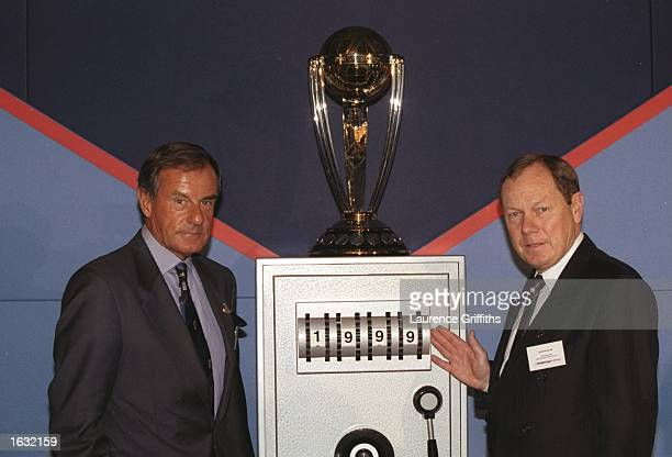 Lord MacLaurin ChiefExecutive of ECB and David Richards ChiefExecutive of the ICC pose with the 1999 World Cricket Cup Trophy in London England...