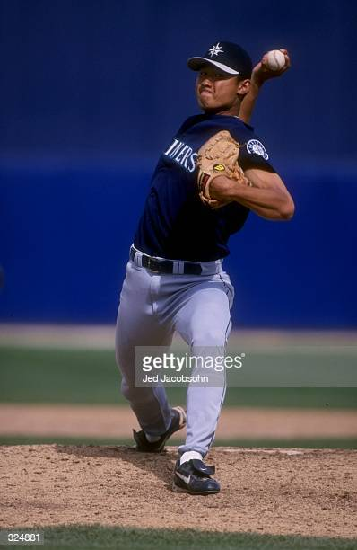 Mac Suzuki of the Seattle Mariners winds up to throw a pitch during the Mariners 189 spring training win over the Milwaukee Brewers at Maryvale...