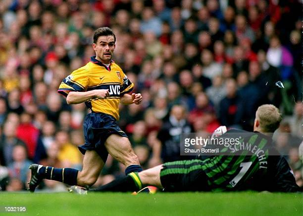 Marc Overmars of Arsenal scores the winner against Manchester United during the FA Carling Premiership match at Old Trafford in Manchester England...