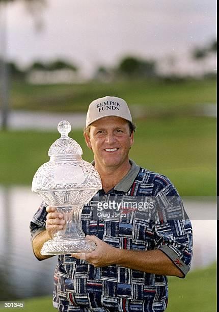 Mark Calcavecchia poses with a trophy during the Honda Classic at the TPC at Heron Bay in Coral Springs, Florida. Mandatory Credit: Craig Jones...