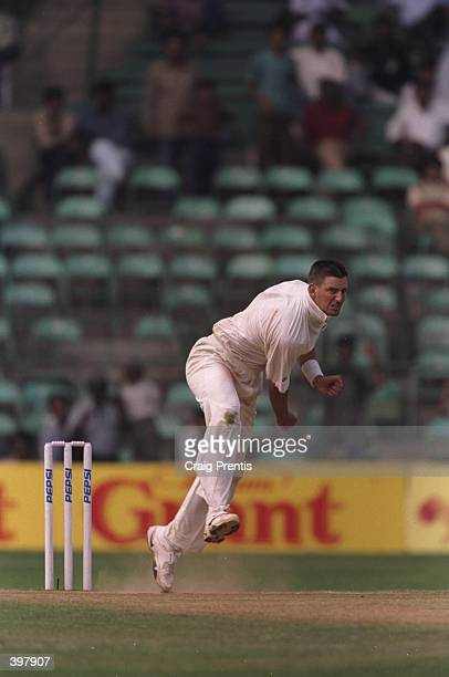 Mike Kapsrowicz of Australia shows his bowling skills during the match between India and Australia in the third test played at the M Chinnaswamy...