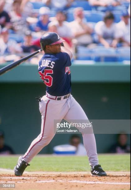 Outfielder Andruw Jones of the Atlanta Braves in action during a spring training game against the Kansas City Royals at the Baseball City Stadium in...