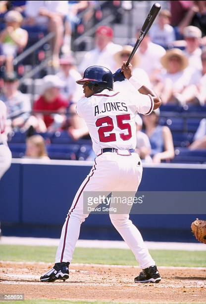 Outfielder Andruw Jones of the Atlanta Braves in action during a spring training game against the Boston Red Sox at Turner Field in Atlanta Georgia...