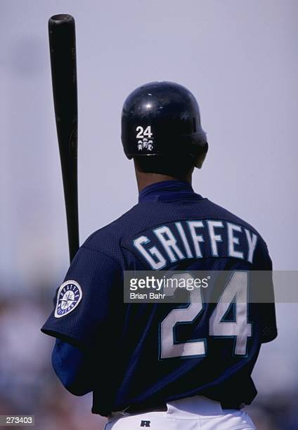 Outfielder Ken Griffey Jr of the Seattle Mariners in action during a spring training game against the Anaheim Angels at the Peoria Sports Complex in...