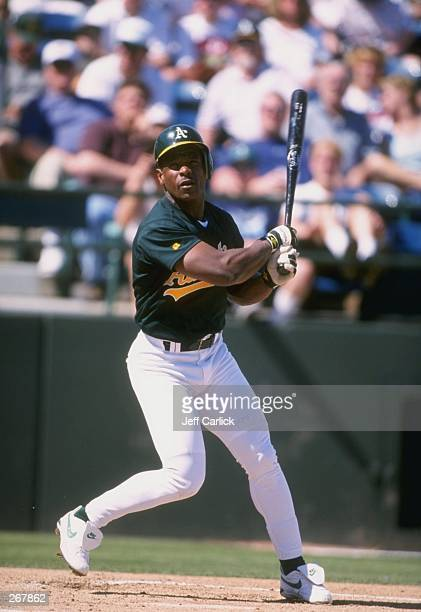 Outfielder Rickey Henderson of the Oakland Athletics in action during a spring training game against the Seattle Mariners at the Phoenix Municipal...