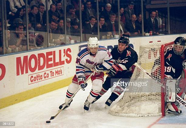 Pat LaFontaine of the New York Rangers is pursued by Wayne Primeau of the Buffalo Sabres during a game at Madison Square Garden in New York City New...