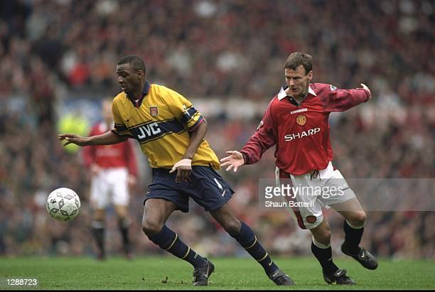 Patrick Vieira of Arsenal gets away from Teddy Sheringham of Manchester United during an FA Carling Premiership match at Old Trafford in Manchester...