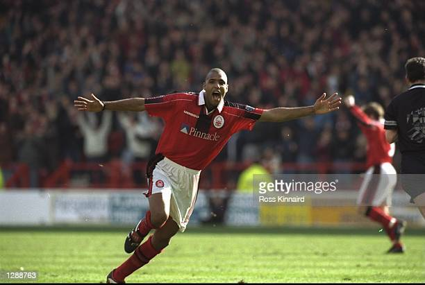 Pierre Van Hooijdonk of Nottingham Forest celebrates during a Nationwide League Division One match against Middlesbrough at the City Ground in...