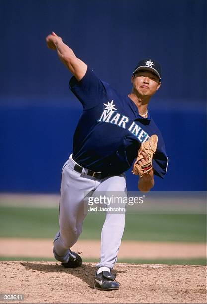 Pitcher Mac Suzuki of the Seattle Mariners in action during a spring training game against the Milwaukee Brewers at the Maryvale Sports Complex in...