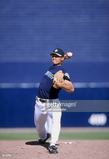 Pitcher Mac Suzuki of the Seattle Mariners in action during a spring training game against the Oakland Athletics at the Peoria Sports Complex in...