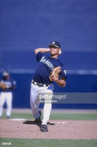 Pitcher Mac Suzuki of the Seattle Mariners in action during a spring training game against the Oakland A''s at the Peoria Sports Complex in Peoria...