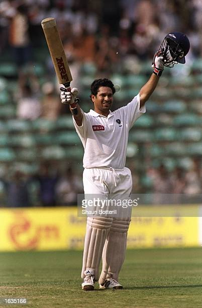 Sachin Tendulkar of India celebrates reaching the century mark during the third test between India and Australia played in Bangalore India Australia...