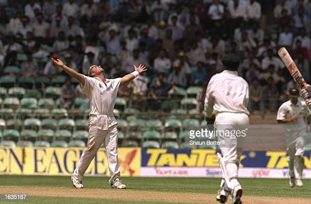 Shane Warne of Australia looks towards the heavens after dismissing Indian batsman Navjot Sidhu during the third test between India and Australia...