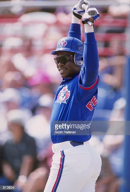 Tony Fernandez of the Toronto Blue Jays looks on during a spring training game against the New York Yankees at Legends Field in Tampa Bay Florida The...