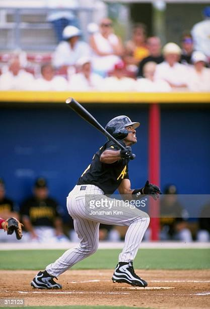 Tony Womack of the Pittsburgh Pirates in action during a spring training game against the Texas Rangers at the Charlotte County Stadium in Port...