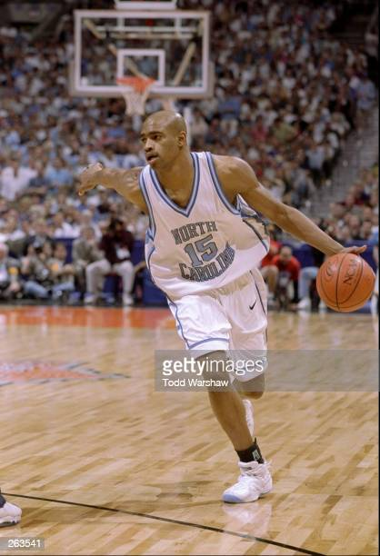Vince Carter of the North Carolina Tar Heels moves the ball down the court during an NCAA Final Four semi final game against the Utah Utes at the...