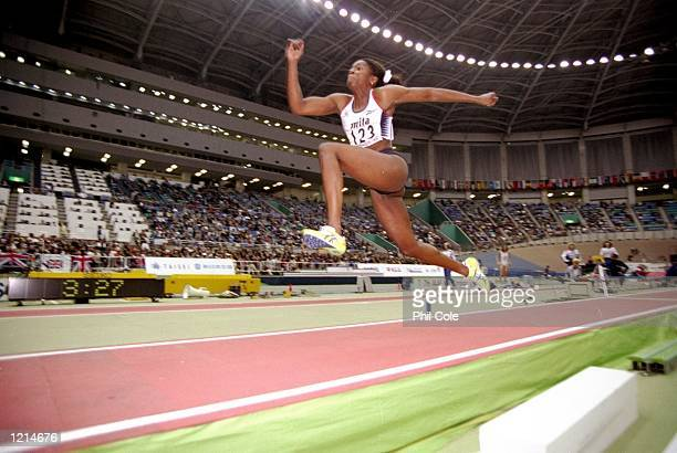 Ashia Hansen of Great Britain leaping to victory in triple jump during the IAAF World Indoor Championships at the Green Dome in Maebashi Japan...