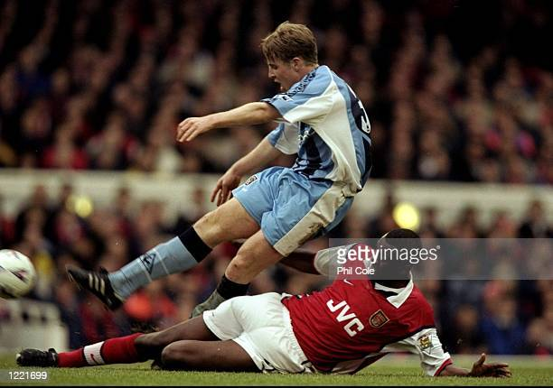 Barry Quinn of Coventry is tackled by Patrick Vieira of Arsenal during the FA Carling Premiership match played at Highbury in London, England. \...