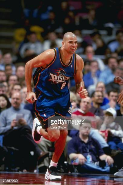 Bison Dele of the Detroit Pistons smiles as he runs down the court during a game against the New Jersey Nets at the Continental Airlines Arena in...