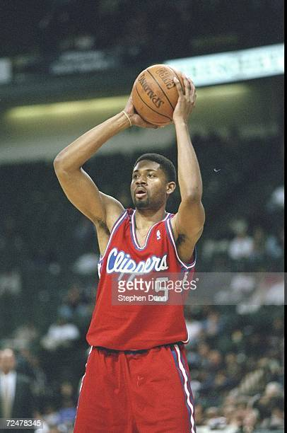 Charles Smith of the Los Angeles Clippers looking to pass the ball during the game against the Dallas Mavericks at the Reunion Arena in Dallas Texas...